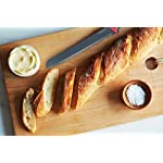 Westmark Non-Stick Bread Knife with Cover, 7.8-inch (Red/Black) 10 GERMAN ENGINEERED HIGH QUALITY KITCHENWARE: Westmark's Bread Knife is among the best in the world and is rated to be one of the best kitchenware brands available today. MATERIAL: Each product is made using a high quality stainless steel blade with a polypropylene handle. Included is a thermoplastic elastomeric knife cover to protect you and your knife. See below for more details. EASY AND READY TO USE: This easy to use product can thoroughly cut through any kind of bread, fruit, vegetable, meat and much more!Equipped with an ergonomic handle, Westmark's product ensures a secure grip making the bread knife efficient and comfortable to use.