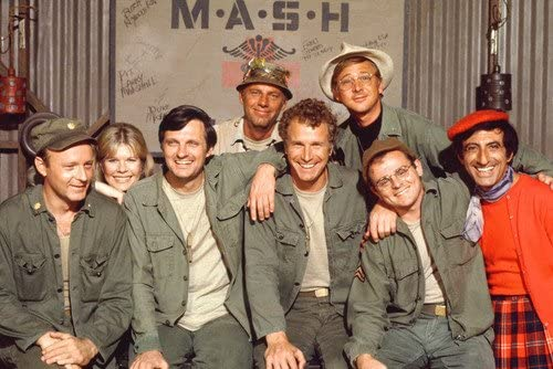 M.A.S.H. Alan Alda and cast pose in front of M.A.S.H sign Portrait 24X36  Poster at Amazon's Entertainment Collectibles Store