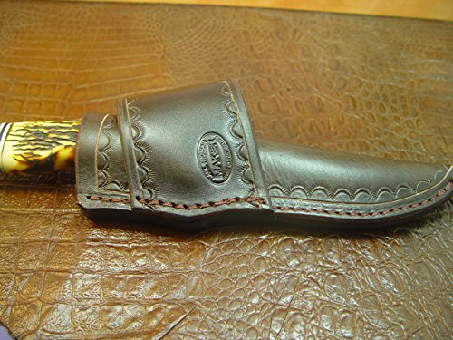 A Custom Handmade Cross Draw Knife Sheath for a Schrade Uncle Henry Golden Spike. The Sheath Is Made Out of 10 Ounce Water Buffalo Leather Hide and Is…