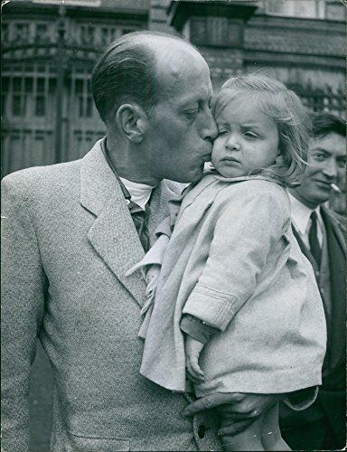 Vintage photo of AN OLD MAN KISSING A BABY GIRL ()