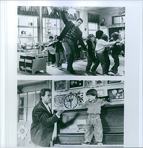 Vintage photo of Former professional bodybuilder, actor and politician Arnold Schwarzenegger seen with a group of child in the scene of film