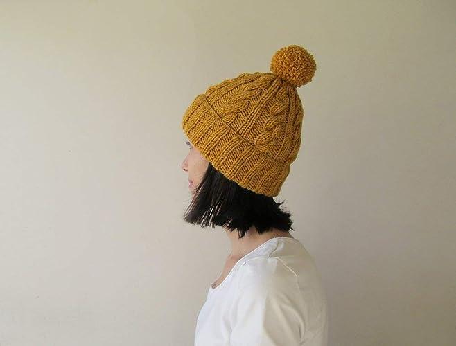 7ca2cc87f5e25 Amazon.com  Cable Knit Hat in Saffron
