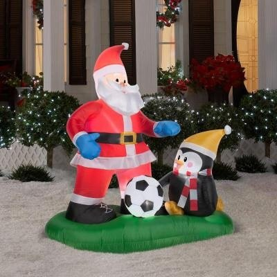Santa and Penguin Playing Soccer Inflatable Yard Art 5' Tall (1) by Airblown
