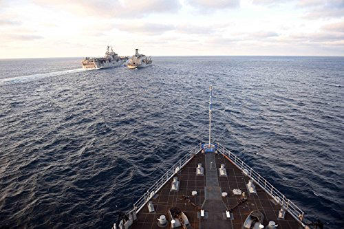 Home Comforts Laminated Poster The Amphibious Dock Landing Ship USS Carter Hall (LSD 50) approaches USS Bataan (LHD 5), Left, and U Vivid Imagery Poster Print 24 x 36