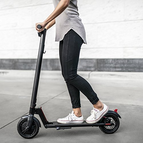 girl riding the GXL electric scooter