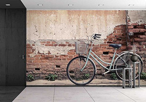 Vintage Bicycle with Old Brick Wall and Copy Space