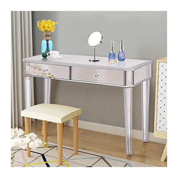 """Tangkula Mirrored Makeup Table Desk Vanity for Women with 2 Drawers Home Office Smooth Silver Finish Vanity Dressing Table for Women Large Storage Drawers Writing Desk Modern Media Console Table - 【Shimmering Desktop】 With a total size of 43.5""""x16""""x30""""(LXWXH), it dresses a total of silver mirror and its shimmering appearance can easily catch your eyeballs. Its smooth surface is easy to clean for you, wiping out your cleaning annoyance. 【Ample Storage Drawers】 Made of solid MDF and sliver mirror, it features large storage drawers with 17""""x12""""x3""""(LXWXH) of each space, which can well accommodate your various kinds of accessories or stuffs, such as your notebooks, cosmetics or other private things. 【Practicable Mirrored Table】 It is widely applied in home as a perfect make up desk for its spacious work area. Its compact structure and beautiful texture can surprisingly highlight your home deco, perfect for your office, store, living room, or bed room. - living-room-furniture, living-room, console-tables - 513BCL2W76L. SS570  -"""