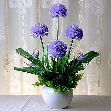 El salón está decorado con motivos florales flor emulación emulación de alta tulip arreglo floral