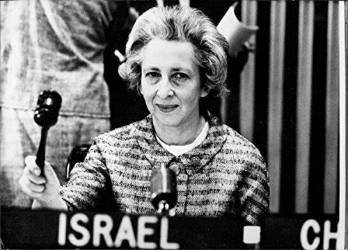 Vintage photo of Zina Harman giving speech.