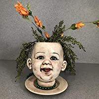 Baby doll head flower pot