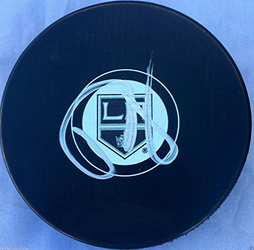 DREW DOUGHTY SIGNED LOS ANGELES KINGS PUCK 2012 2014 STANLEY CUP CHAMPIONS J2