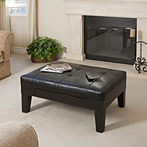 Black leather table infront of fireplace