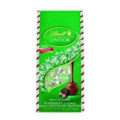 Limited Edition Lindor Milk Peppermint Cookie features a delicate milk chocolate shell infused with cookie pieces which envelops an irresistibly smooth peppermint truffle filling. The premium Lindor Milk Peppermint Cookie bag features a festi...