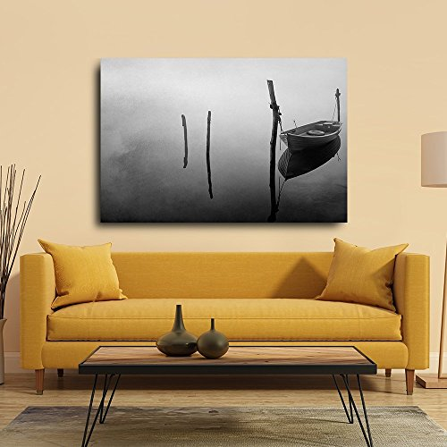 Black and White Photo of a Lone Boat Floating on a Lake