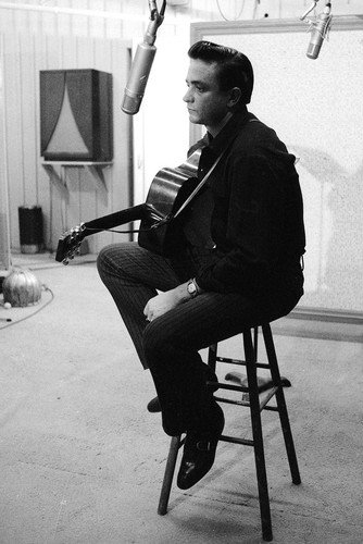 Johnny Cash Poster iconic sitting on chair in recording studio with guitar