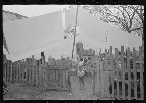 Photo: Back yard in Mexican district with laundry on line,San - Shopping Antonio Texas In San