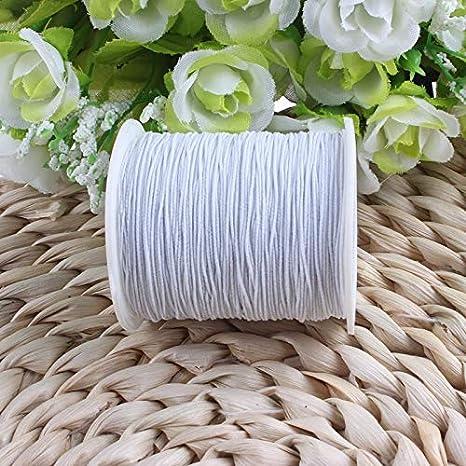Rollo de hilo elástico de color blanco para máquina de coser de ...