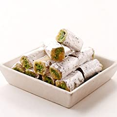 This delicious Kaju-Pista roll is rich in flavour and loaded with crushed Pista . It is an ideal light dessert - just one piece after meals will leave you satisfied. Coming from Kandoi, one of the oldest & most reputed shop of coun...