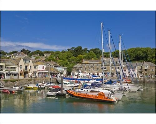 Photographic Print of Busy tourist shops, small boats and yachts at high tide in Padstow - Town At Harbour Shops