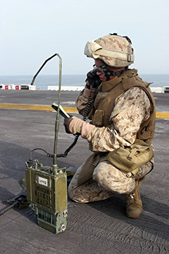 April 1 2007 - A US Marine calls in a simulated casualty report aboard amphibious assault ship USS Bataan while under way in the Persian Gulf Poster Print (22 x 33) ()