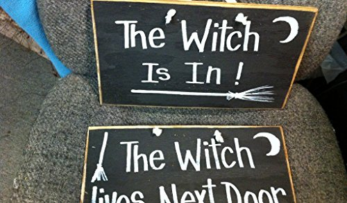 The Witch is In Lives next door sign set of 2 ()