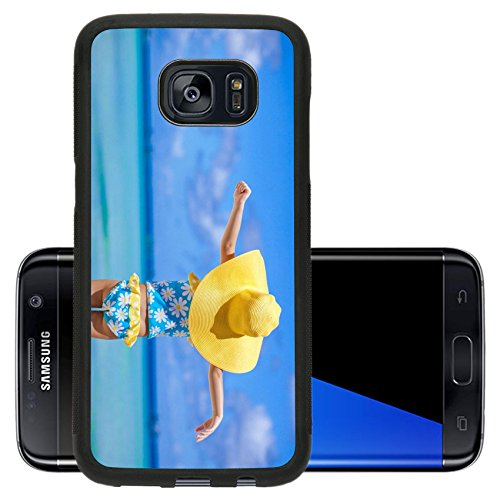 Luxlady Premium Samsung Galaxy S7 Edge Aluminum Backplate Bumper Snap Case IMAGE 21124957 Rear view of baby girl in big hat looking at the sea on white sand beach