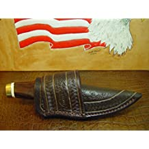 New Buck Vanguard Cross Draw Knife Sheath. Made of 10 Oz Water Buffalo Leather and Has a Rope Pattern Tooling with Random Patterning in the Center of the Sheath. Sheath ONLY!