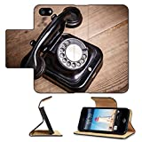 MSD Premium Apple iPhone 5 iPhone 5S Flip Pu Leather Wallet Case iPhone5 IMAGE ID: 30983953 Old black phone with dust and scratches isolated on wooden retro floor