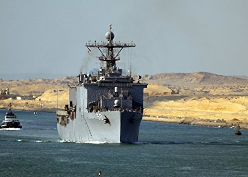 Home Comforts Laminated Poster The Amphibious Dock Landing Ship USS Carter Hall transits The Suez Canal. Carter Hall is Deployed as Vivid Imagery Poster Print 24 x 36