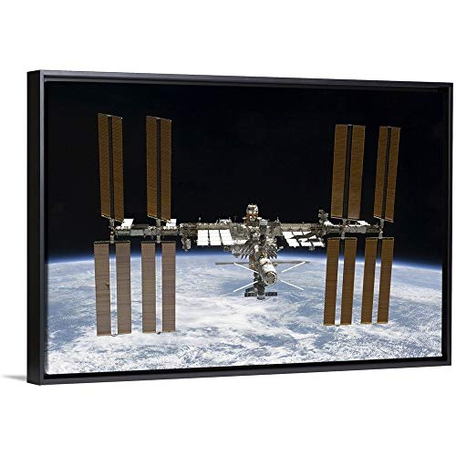 The International Space Station in Orbit Above Earth Black Floating Frame Canvas Art, 50