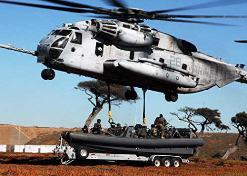 Home Comforts A Marine Corps CH-53 Helicopter Lifts a Rigid Hull Inflatable Boat (RHIB), from Special Boat Team (S