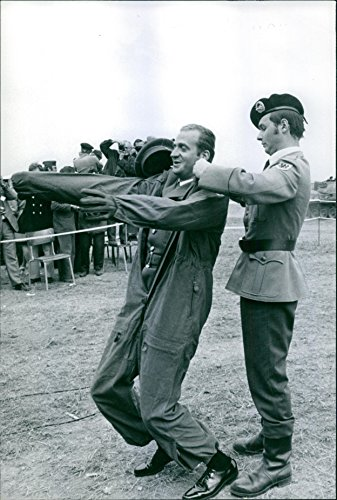 Officer Jumpsuit (Vintage photo of An officer putting a jump suit on Prince Juan Carlos de Borb243;n. 1972.)
