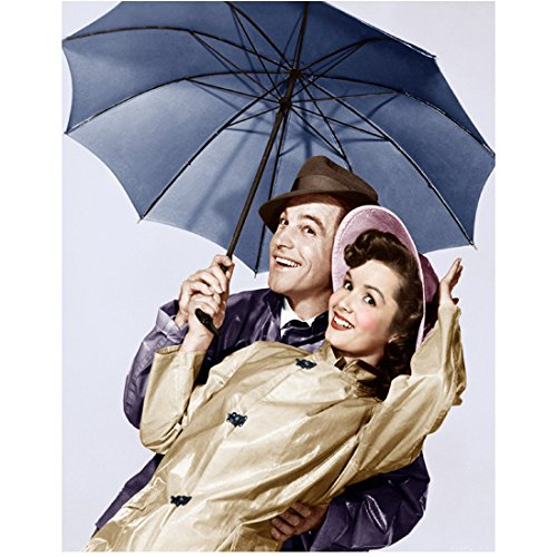 debbie-reynolds-and-gene-kelly-singing-in-the-rain-under-umbrella-8-x-10-inch-photo
