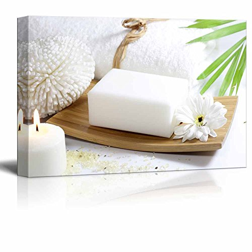 Relaxing Spa Counter with White Soap Burning Candles and Blooming Flower Wall Decor ation