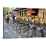 """GREATBIGCANVAS Gallery-Wrapped Canvas Entitled A Rack of Rental Bicycles are Part of The Velib, a Bike Transit System in Paris, France by David R. Frazier 48""""x32"""""""