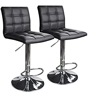 Two stools with black seats and metal frames