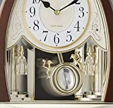 "Rhythm Clocks ""Joyful Crystal Bells"" Musical Motion Mantel Clock"