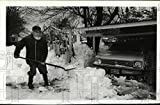 1980 Press Photo Andrew S Germain shovels snow from his carport in Cascade Locks