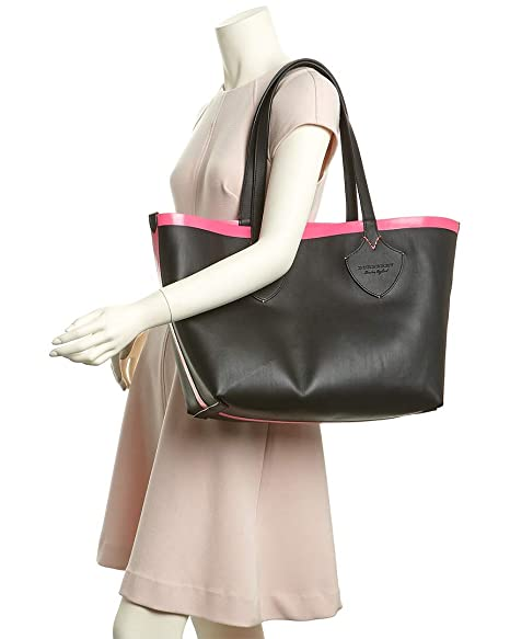 e670ab24c0 Amazon.com: Burberry Women's Medium Giant Reversible Tote in Canvas and  Leather Pink: Clothing