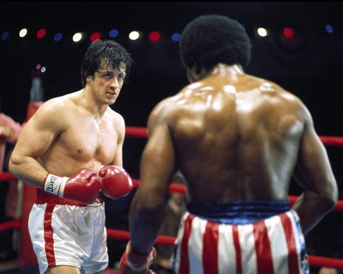 Sylvester Stallone and Carl Weathers in Rocky III face each other in ring 8x10 Promotional Photograph
