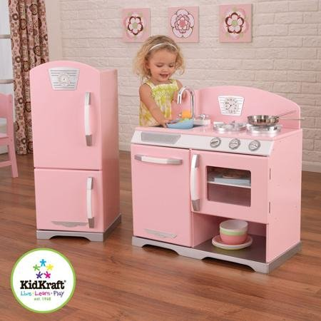 Pink retro Wooden Play Kitchen and Refrigerator With stainless steel dishwasher a removable sink for an easy cleanup by KidKraft