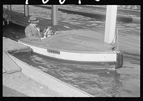 Historic Photos 1939 Photo Glen Echo, Maryland. A man and a little girl taking a ride in a motor boat at Glen Echo Park Location: Glen Echo, Maryland, Montgomery County -