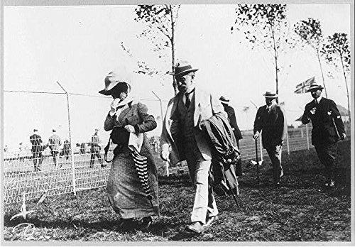 Photo: Isaac Newton Seligman,Wife,Guta Loeb Seligman,walking alongside fence,June 1911