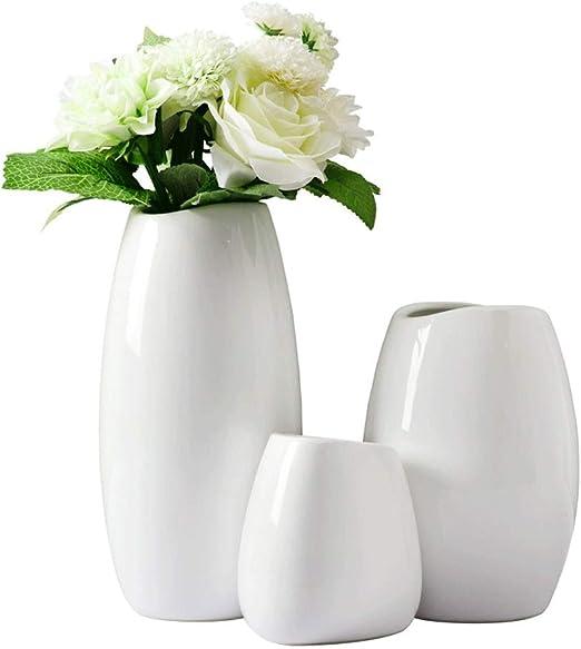 Amazon Com White Ceramic Vase Set Creative Solid Color Dining Table Vase Decoration Living Room Vases For Flowers Arrangement Modern Minimalist Home Decoration Home Kitchen