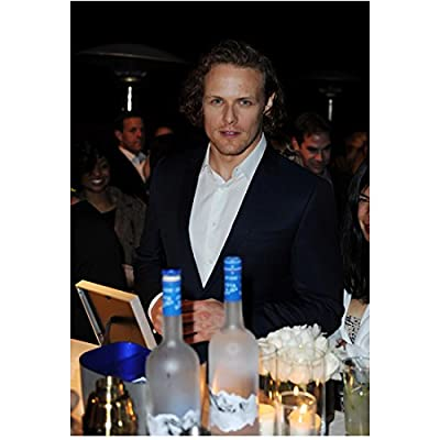 Sam Heughan Standing at Bar Smiling 8 x 10 inch Photo