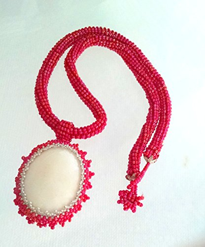 snowy-white-stone-wrapped-in-red-seed-bead-beaded-bezel-pendant-on-red-beaded-tubular-20-inch-rope