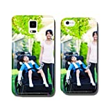 Disabled little boy in wheelchair with sister on grassy lawn out cell phone cover case Samsung S5