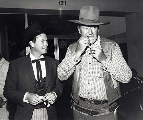 John Wayne rolling a cigarette in cowboy
