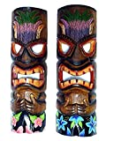 2 Brown Tiki Masks with Headdress Wearing Tropical Board Shorts