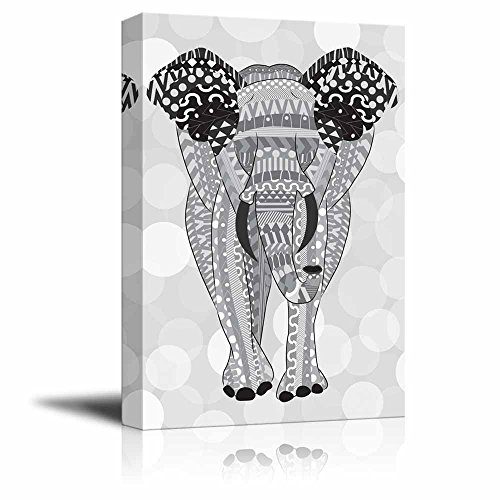 Gray hand drawn zentangle elephant on a silver colored bokeh background